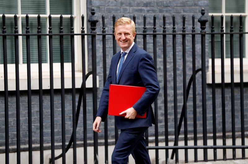 © Reuters. FILE PHOTO: Britain's Digital, Culture, Media and Sport Secretary Oliver Dowden walks outside Downing Street in London