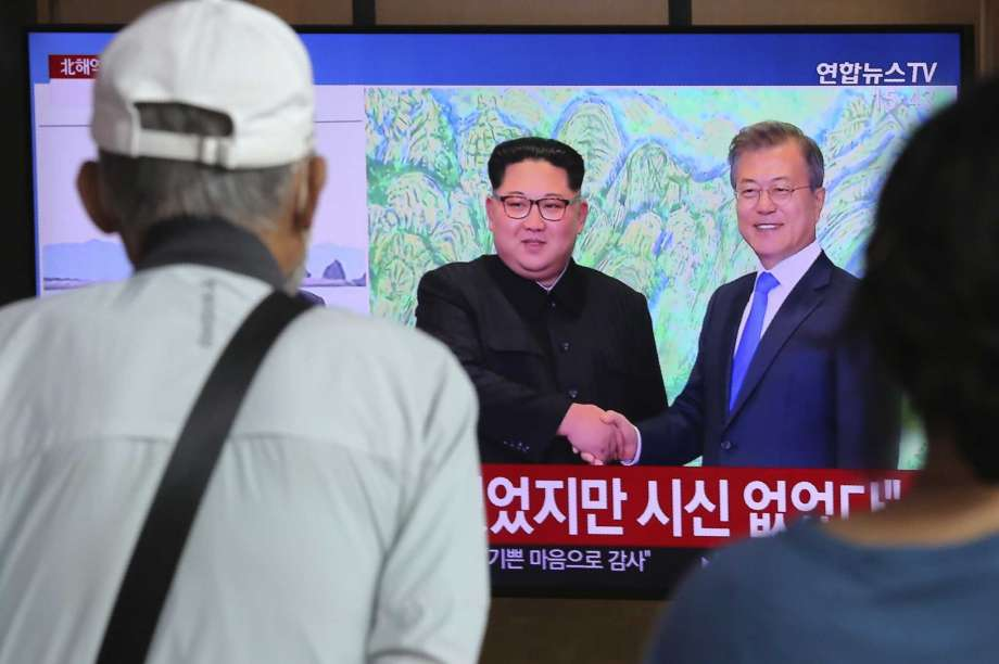 "People watch a TV showing a file image of North Korean leader Kim Jong Un, left, and South Korean President Moon Jae-in during a news program at the Seoul Railway Station in Seoul, South Korea, Friday, Sept. 25, 2020. North Korean leader Kim apologized Friday over the killing of a South Korea official near the rivals' disputed sea boundary, saying he's ""very sorry"" about the incident he called unexpected and unfortunate, South Korean officials said. Photo: Ahn Young-joon, AP / AP2010"