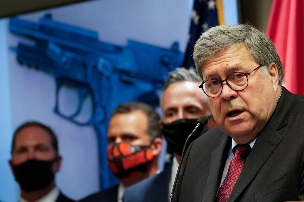 Attorney General William Barr talks to the media during a news conference about Operation Legend, a federal task force formed to fight violent crime in several cities, on Aug. 19, 2020, in Kansas City, Mo.