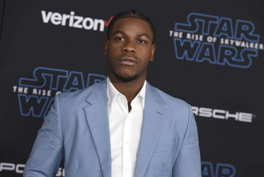 """FILE - In this  Monday, Dec. 16, 2019 file photo, John Boyega arrives at the world premiere of """"Star Wars: The Rise of Skywalker"""" in Los Angeles. British perfume brand Jo Malone has apologized to Black actor John Boyega of """"Star Wars"""" fame after cutting him out of the Chinese version of a cologne commercial he helped create.  (Jordan Strauss/Invision/AP, File) Photo: Jordan Strauss, Jordan Strauss/Invision/AP / Invision"""