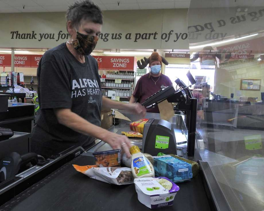 Brenda Donajkowski rings up groceries on the last day of business at Neiman's Family Market in Alpena, Mich., on Tuesday, Sept. 22, 2020. The store closed after 37 years in the northern Michigan community.( Julie Riddle/The Alpena News via AP) Photo: Julie Riddle, AP / The Alpena News