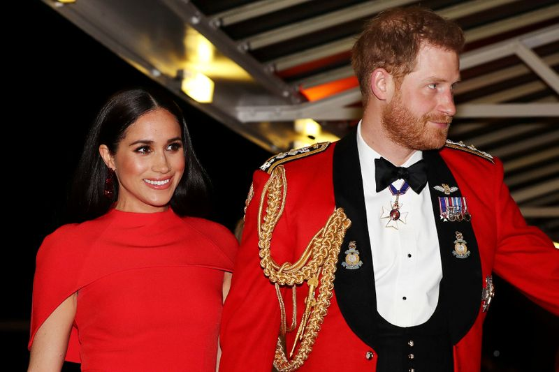 © Reuters. FILE PHOTO: The Duke and Duchess of Sussex attend The Mountbatten Festival of Music in London