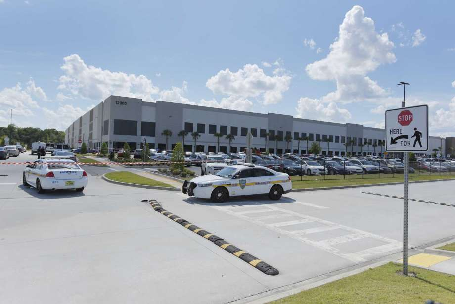 FILE - In this Monday, June 29, 2020, file photo, law enforcement respond to a report of a shooting at the Amazon Fulfillment Center on Pecan Park Road near the Jacksonville International Airport in Jacksonville, Fla. The Jacksonville Sheriff's Department said on its Twitter account late Tuesday, Sept. 29, 2020, that there was a report of a shooting at the Amazon Fulfillment Center. The center was also the site of a shooting in June. (Bob Self/The Florida Times-Union via AP, File) Photo: Bob Self, AP / Copyright The Florida Times-Union 2020
