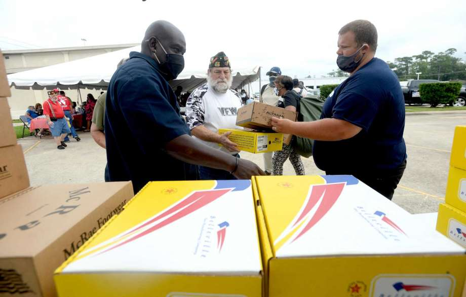 Albert Darby (left) and Donald Lotman gather boxes of boots donated from area army bases for veteran Jeff Courts during the annual Southeast Texas Stand Down 2020 held at the Veteran's Center in Beaumont Friday. Multiple services, agencies, and give-aways were available for veterans and the homeless. Similar events are held through the year in other Southeast Texas locations, including one in May in Orange and in January in Port Arthur. Photo taken Friday, September 25, 2020 Kim Brent/The Enterprise Photo: Kim Brent / The Enterprise / BEN