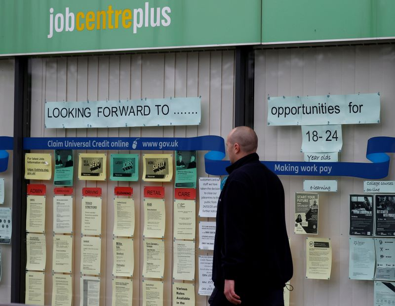 © Reuters. FILE PHOTO: A man walks past a job centre following the outbreak of the coronavirus disease (COVID-19), in Manchester