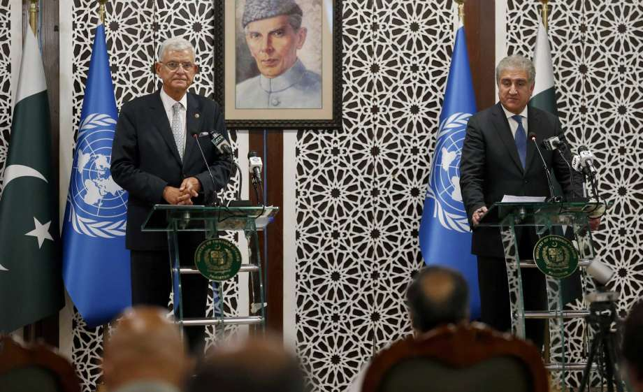 United Nations General Assembly President-elect Volkan Bozkir, left, and Pakistan Foreign Minister Shah Mahmood Qureshi give a joint press conference in Islamabad, Pakistan, Monday, Aug. 10, 2020. Bozkir arrived in Islamabad on a two-day visit. Portrait in background show Muhammad Ali Jinnah, founder of Pakistan. Photo: Anjum Naveed, AP / Copyright 2020 The Associated Press. All rights reserved.