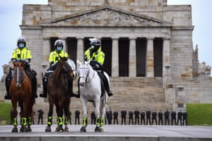 Police stand guard in front of the Shrine of Remembrance during an anti-lockdown rally in Melbourne