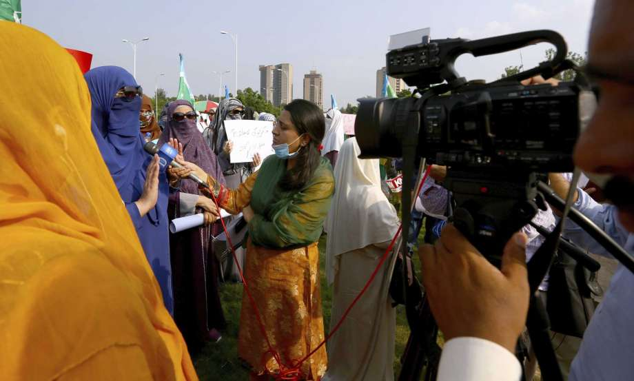 In this Friday, Sept. 11, 2020 photo, Wajiha Khanian, a female journalist from local tv channel Dawn News, interviews during protest, in Islamabad, Pakistan. Social media attacks against Pakistan's women journalists have been vile and vicious, some threatening rape, others even threatening death and the culprits are most often allied to the ruling party, even prompting the Committee to Protect Journalists to issue a statement on Friday condemning the relentless attacks. Photo: Anjum Naveed, AP / Copyright 2020 The Associated Press. All rights reserved.