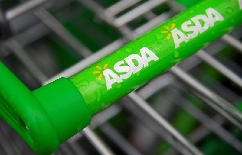 © Reuters. FILE PHOTO: Branding is seen on a shopping trolley at an Asda store in west London, Britain
