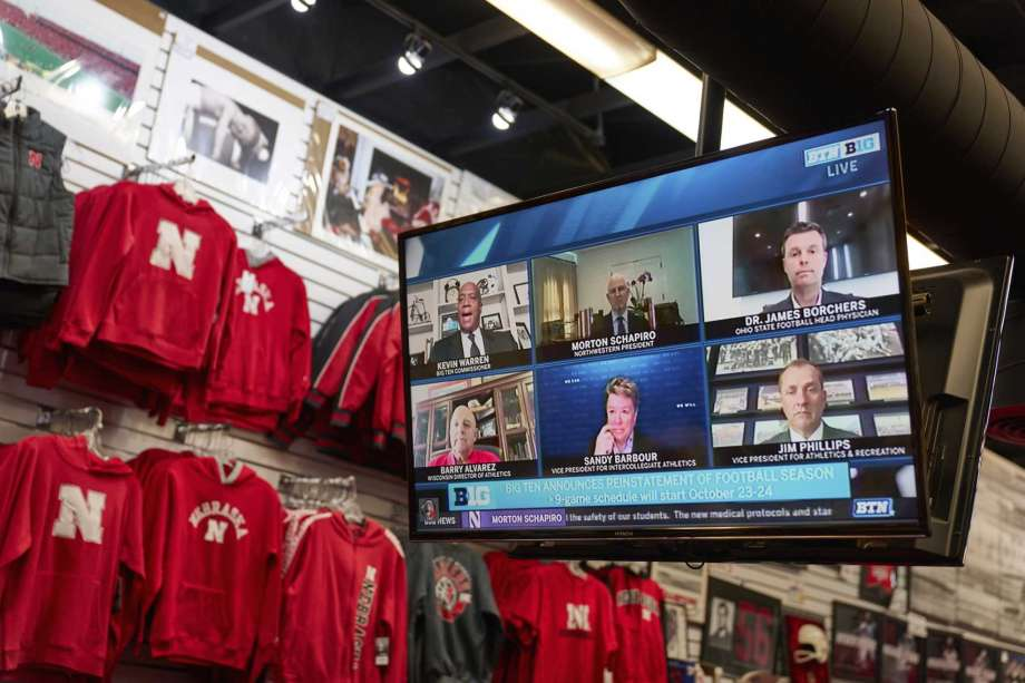 The Husker Hounds sports apparel store in Omaha, Neb., shows on television screens Wednesday, Sept. 16, 2020, a Big Ten virtual news conference to discuss the reopening of the football season. President Donald Trump was quick to spike the ball in celebration when the Big Ten announced the return of fall football at colleges clustered in some of the Midwest battleground states critical to his reelection effort. Photo: Nati Harnik, AP / Copyright 2020 The Associated Press. All rights reserved