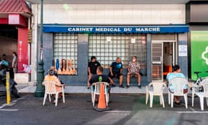 People wait at the doctor's office near the market in Papeete, French Polynesia on 25 August 2020, amid the coronavirus pandemic.