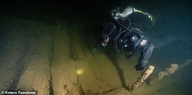 Museum researcher Chris Sabick during a regular inspection of the Phoenix wreckage in 2019. The shipwreck is a popular destination for scuba divers, and anchors and other items have been recovered before, but nothing on the scale of the paddle wheels