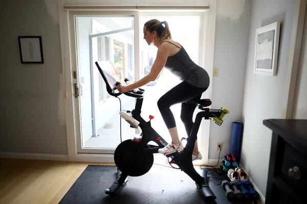 Jen Van Santvoord rides her Peloton bike at her home in San Anselmo, Calif.The company made $89 million in profit in the three months ended June 30.