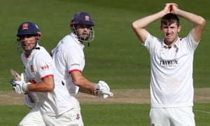 Sir Alastair Cook (left) and Nick Browne (centre) of Essex run quick singles as Craig Overton looks on.