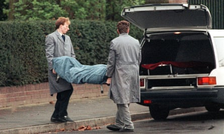 Rohwedder's body is removed from his home in Düsseldorf.
