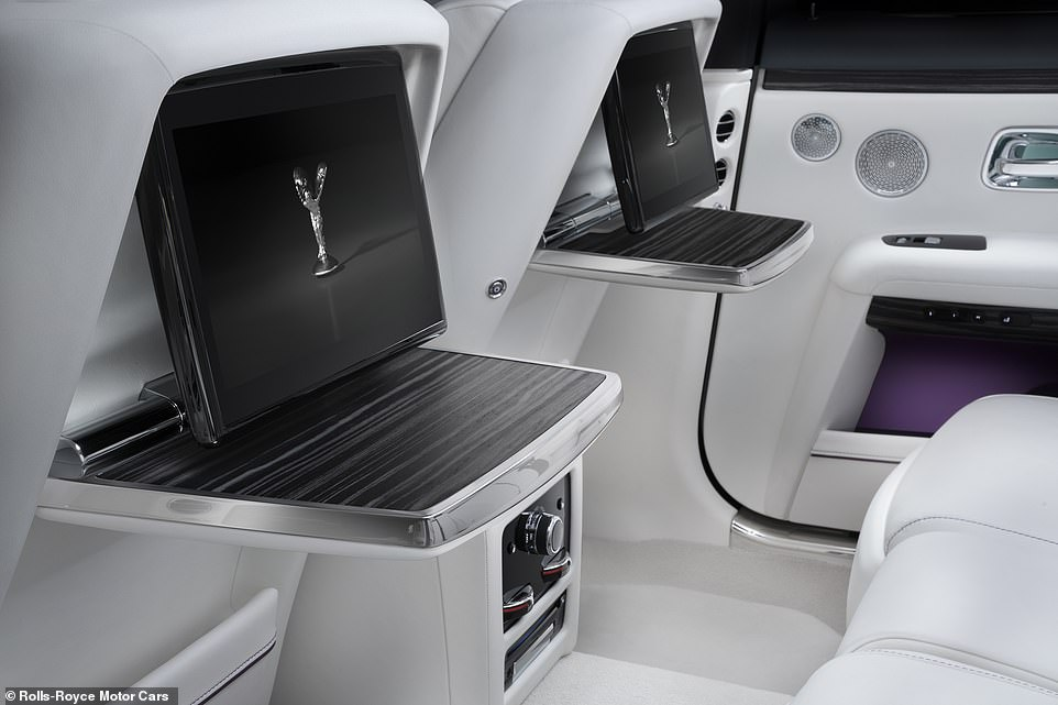 Just because it's minimalist doesn't mean it isn't laden with technology. Rear-seat passengers get drop-down screen and tables