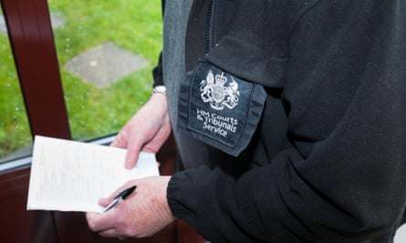 An HM Courts & Tribunals Service court bailiff serving an eviction warrant notice