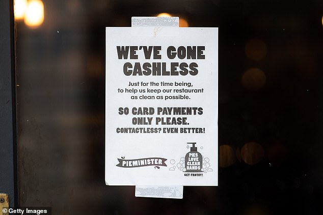 A sign in the window of a Pieminister restaurant in Cardiff, Wales, informing customers the store has gone cashless as a COVID-19 measure on March 17, 2020.Half of the people TCU spoke with are using less cash than they were prior to the pandemic, and 60 percent don't think they'll go back to using it regularly when it ends