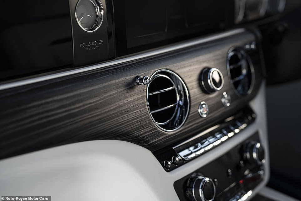 The dashboard has a limited number of toggles and switches to keep it feeling minimalist and sleek as part of Rolls-Royce's efforts to 'declutter' the cabin