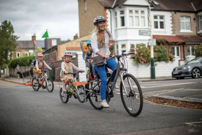 Melinda Marchal cycles with her children to and from school in London