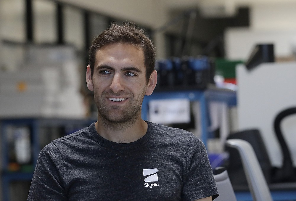 In this June 22, 2018, photo, Adam Bry, founder and CEO of Skydio, is interviewed in Redwood City, Calif. Skateboarders, surfers and YouTube stars used to be the target customers for California drone startup Skydio, which builds sophisticated self-flying machines that can follow people around and capture their best moves on video. Now it's police officers and soldiers getting equipped with the pricey drones. U.S. political and security concerns about the world's dominant consumer drone-maker, China-based DJI, have opened the door for Skydio and other companies to pitch their drones for government and business customers. (AP Photo/Jeff Chiu)