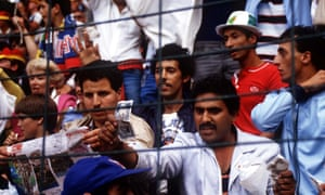 An Algeria fan waves a bank note to allege that West Germany's draw with Austria, which eliminated Algeria, was fixed.