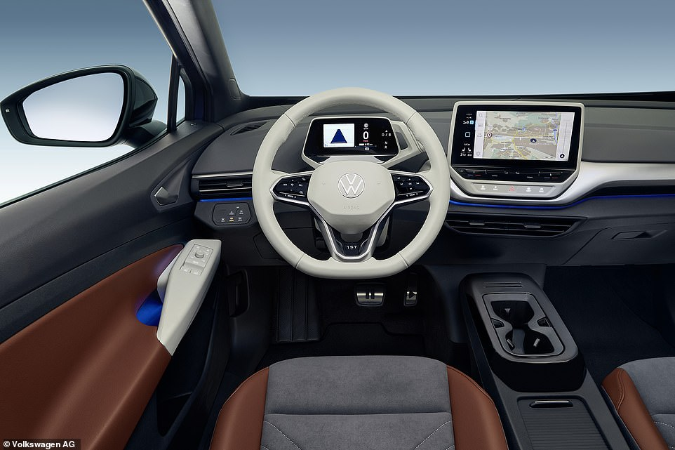 Not a button in sight on the dash: Volkswagen has actively decluttered the dashboard of switches to give the cabin a modern feel