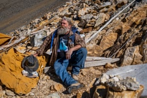 Brian Busse rests after climbing upslope, surface mining for aquamarine crystals, at his 11,500 foot mining claim on Mount Antero, Colorado.