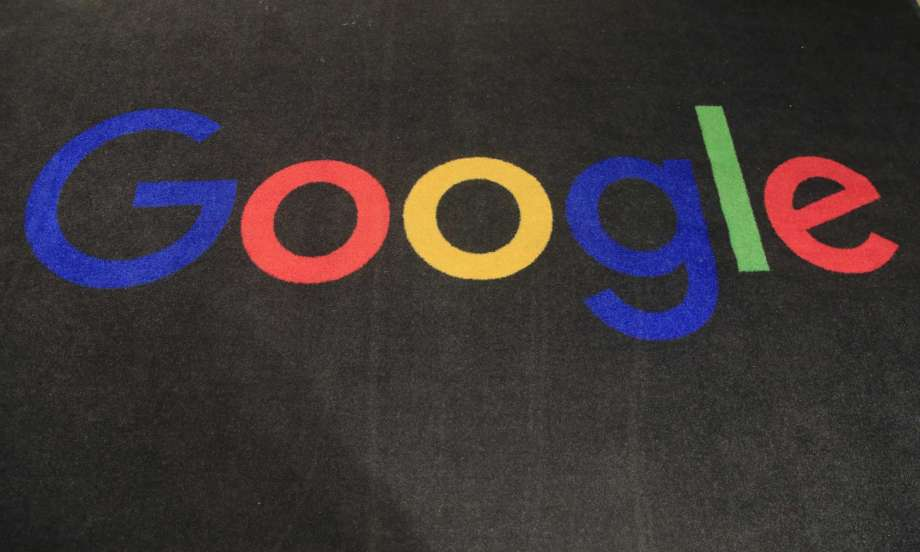 FILE - In this Monday, Nov. 18, 2019, file photo, the logo of Google is displayed on a carpet at the entrance hall of Google France in Paris. The Trump administration's legal assault on Google actually feels like a blast from the past. The U.S. Justice Department filed an equally high-profile case against a technology giant in 1998. Photo: Michel Euler, AP / Copyright 2019 The Associated Press. All rights reserved