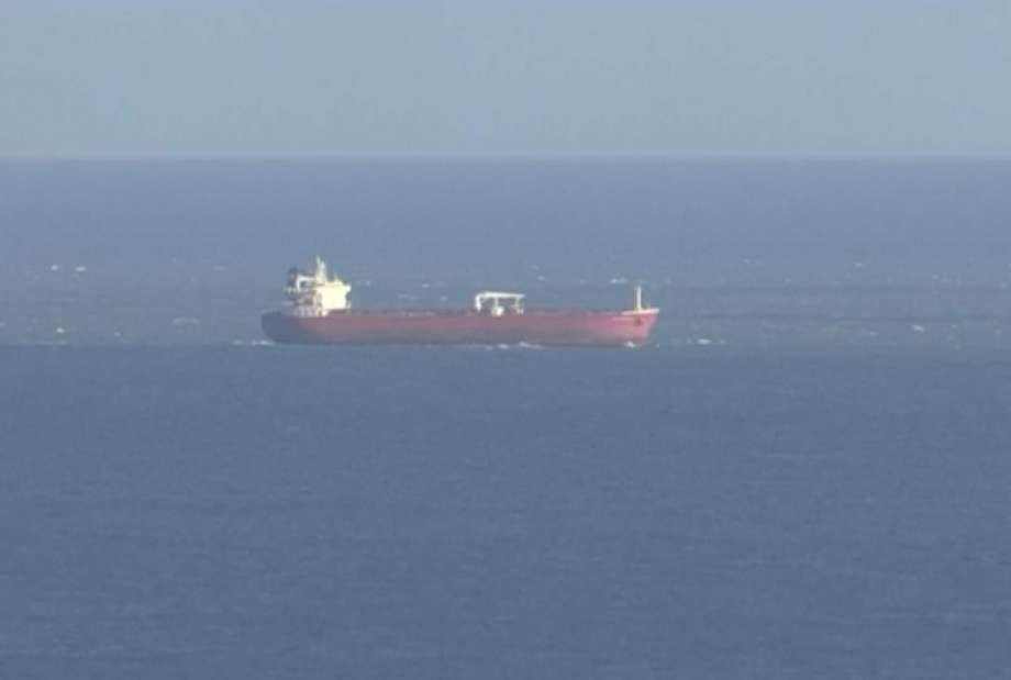 In this image taken from SKY video, shows a tanker at sea, as filmed from land on Sunday Oct. 25, 2020. British police are investigating an undisclosed incident aboard an oil tanker in the English Channel. The incident reportedly took place aboard the Libyan-registered oil tanker Nave Andromeda south of Sandown on Isle of Wight, according to Isle of Wight Radio. (SKY News via AP) Photo: AP / Sky News