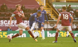 Chelsea's Hakim Ziyech drives in the opening goal at Turf Moor.