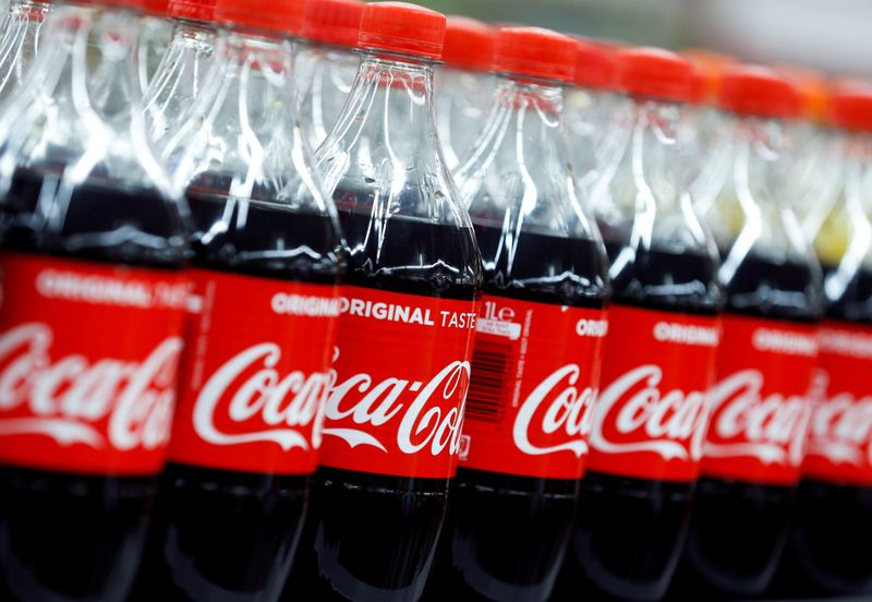 © Reuters. FILE PHOTO: Bottles of Coca-Cola are seen at a Carrefour Hypermarket store in Montreuil, near Paris
