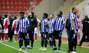 Sheffield Wednesday players keep their eyes on the skies after a drone stopped play at the New Yor Stadium.