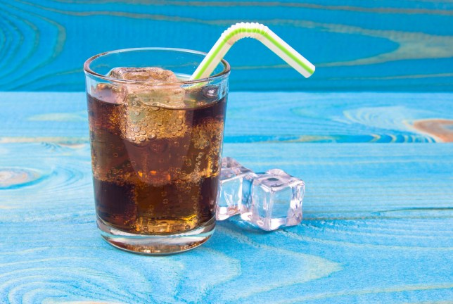 Sweet, fizzy drink with ice on a blue background. Close Up.; Shutterstock ID 781533109; Purchase Order: -