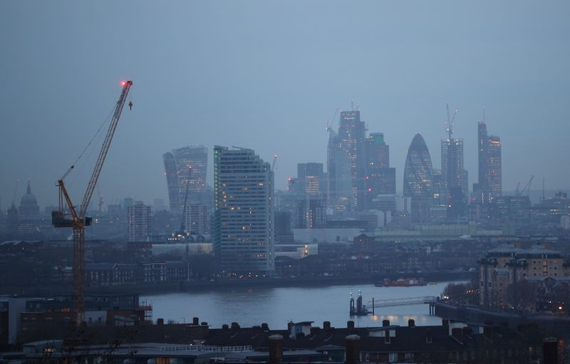 © Reuters. FILE PHOTO:  The City of London financial district is seen during early morning mist from Greenwich Park in London