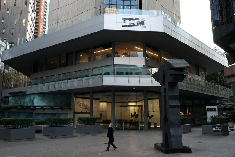 © Reuters. FILE PHOTO: A man wearing a protective mask walks past an office building with IBM logo amidst the easing of the coronavirus disease (COVID-19) restrictions in Sydney