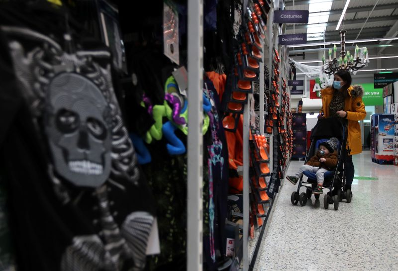© Reuters. A customer looks at the Halloween costumes in the UK supermarket Asda, as the store launches a new sustainability strategy, in Leeds