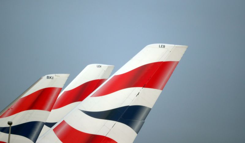 © Reuters. FILE PHOTO: FILE PHOTO: British Airways logos are seen on tail fins at Heathrow Airport in west London