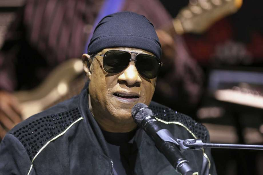 "FILE - In this Nov. 27, 2018, file photo, Stevie Wonder performs live at a news press conference for the ""House Full of Toys 22nd annual Benefit Concert"" in Los Angeles. Stevie Wonder is back in his home state of Michigan to get out the vote for Joe Biden, Saturday, Oct. 31, 2020. ""The only way we're gonna win this fight, a fight against injustice, is by voting,"" he told a crowd gathered at a drive-in rally in Detroit. (Photo by Willy Sanjuan/Invision/AP, File) Photo: Willy Sanjuan, Willy Sanjuan/Invision/AP / 2018 Invision"