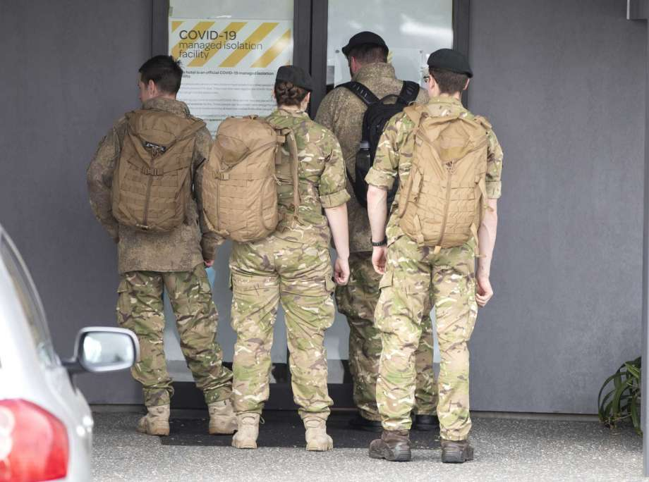 Military personnel arrive at the Sudima Hotel in Christchurch, New Zealand, Tuesday, Oct. 20, 2020.  A number of fishing crew who flew into New Zealand on chartered planes have the coronavirus. The crew members have been in quarantine at the Christchurch hotel since they arrived, and tested positive during routine testing, officials said. The news could deal a blow to New Zealand's efforts to restart its fishing industry, which has struggled to find local workers to crew fishing vessels. Photo: Mark Baker, AP / Copyright 2020 The Associated Press. All rights reserved