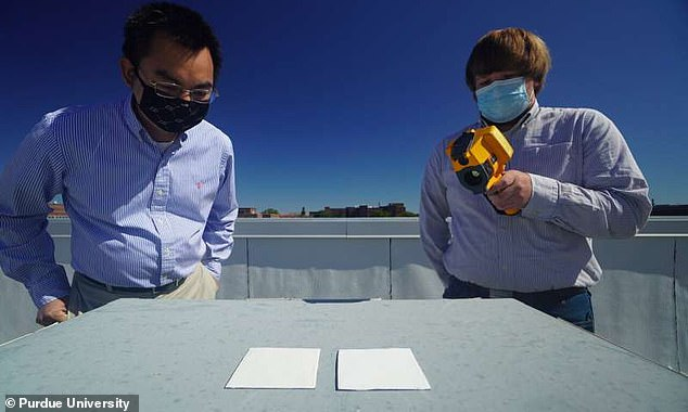 The new acrylic could be used to keep buildings cool naturally. 'This paint may even be used to combat climate change since it rejects sunlight and radiates heat into space,' saysXiulin Ruan (left), professor at Purdue's School of Mechanical Engineering