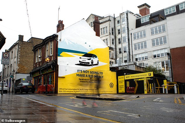 The adverts - this one in Cardiff - are aimed at promoting the ID.3's carbon-neutral production in Germany and general green credentials of the electric car