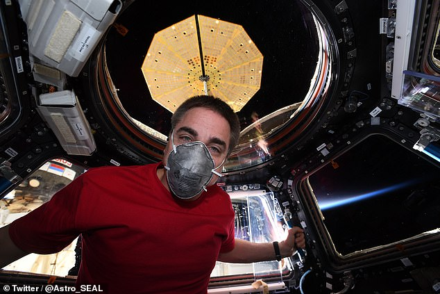 In preparation for his return in a Soyuz capsule tomorrow evening, Mr Cassidy, pictured, tweeted photographs of himself donning a facemask onboard the space station