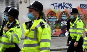 Police officers in masks in London.