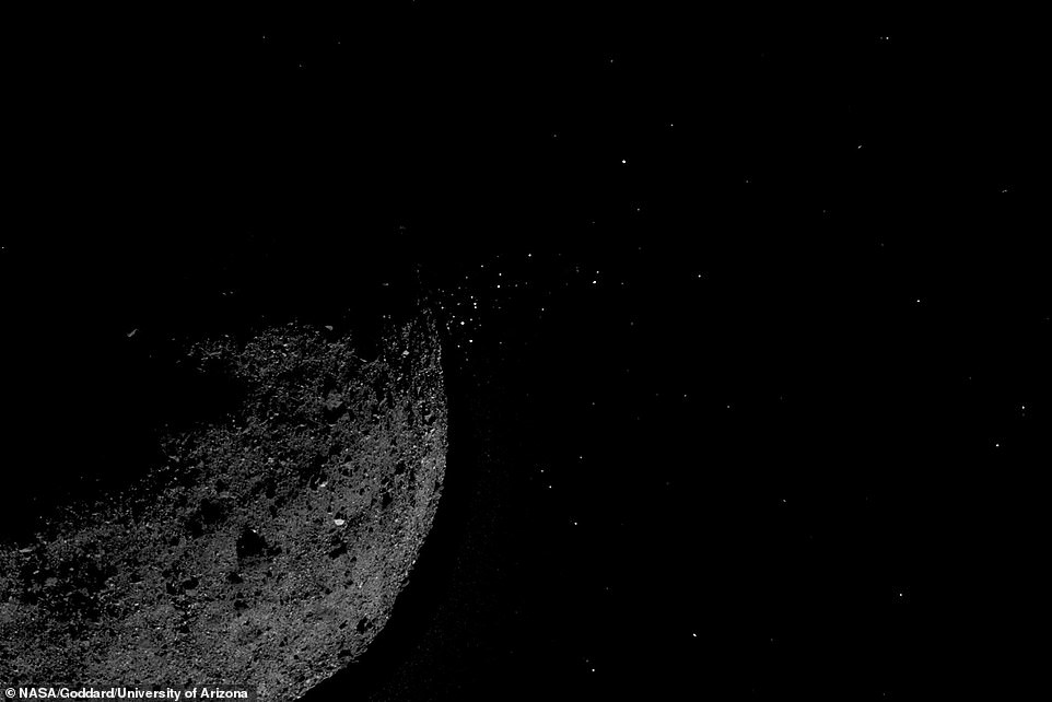 A view across the southern hemisphere of Bennu into space above, showing boulders on the surface