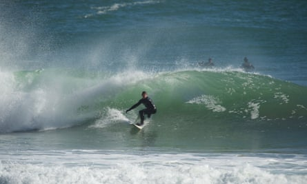 Andy Ainscough from Adventure Parcs winter surfing in Pembrokeshire.
