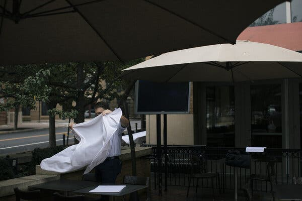 Josh Tex, the manager of Circa at Clarendon, a restaurant in Arlington, Va., prepared the outdoor seating area for customers on Wednesday. Businesses that survived the summer may have to close their doors during the winter.