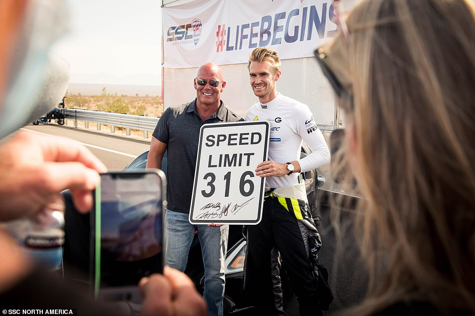 SSC founder and CEO Jerod Shelby (left) - no relation to famed US car designer Carroll Shelby - posing with British racing driver Oliver Webb (right), who was at the wheel for the high-speed run