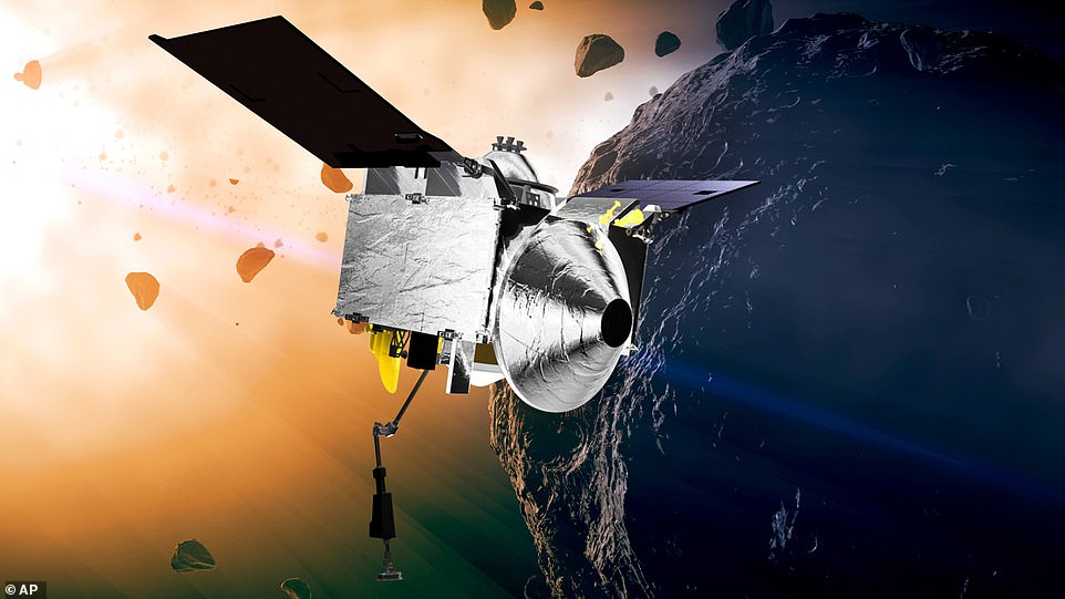 This file illustration provided by NASA depicts the Osiris-Rex spacecraft at the asteroid Bennu