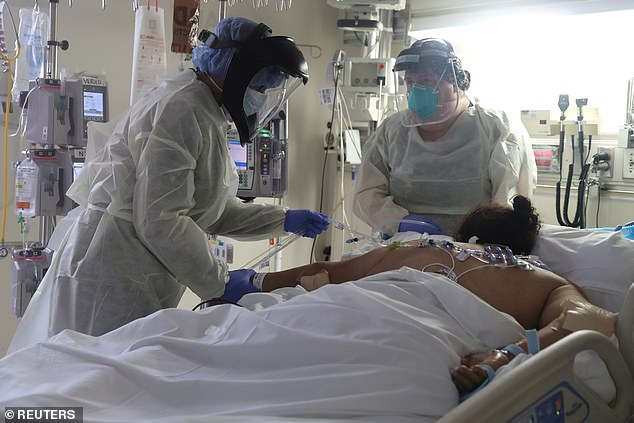 A recent NIH study found remdesivir shortened coronavirus hospital stays by five days and reduces the risk of death by 30%. Pictured:Medical staff attend to a patient suffering from coronavirus in the ICU at Scripps Mercy Hospital in Chula Vista, California, May 12